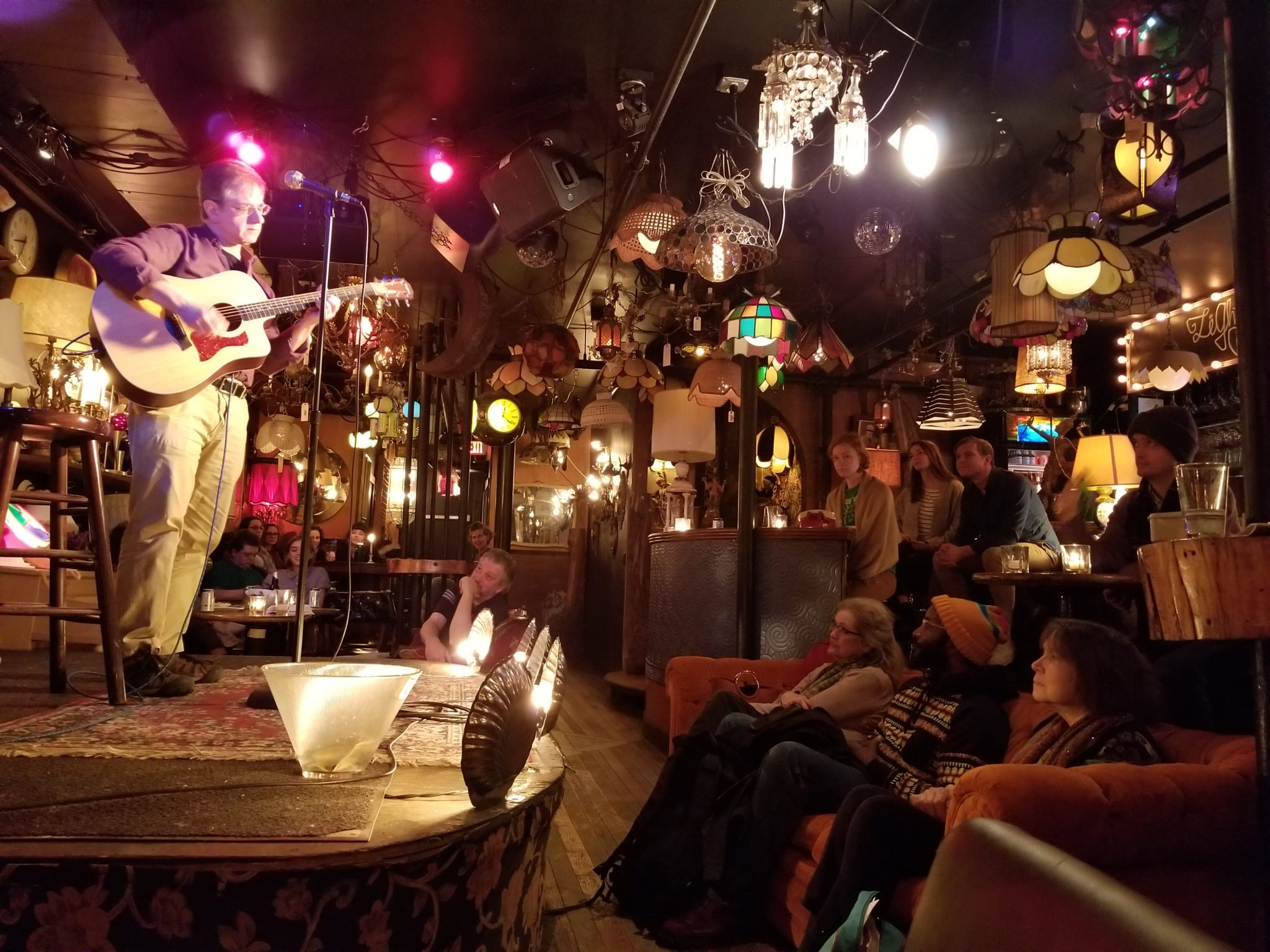 Nate Orshan Performs An Original Song At The 2nd Burlington Writers  Workshop Open Mic Night At The Light Club Lamp Shop.